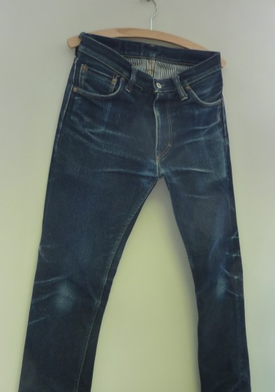 Jeans on display showing  off fade and wear