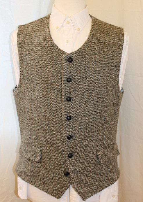 One of a kind Harris Tweed waistcoat by Earl of Bedlam, London-based tailors to stars like Nile Rodgers and Duran Duran. Light green mottled tweed and lined with the Earls custom cuff-printed lining. A great waistcoat. Asking 179 pounds for this unique piece.