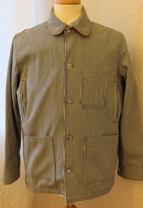 """Hickory-stripe Chore Coat by Ardour Brand. Lovely fabric, cotton lining, made in England. Orange Harris Tweed on the inside of collar and cuffs. 5 front pockets, including 2 side-entry hand-warmers, and one zipped inside pocket. P2P is 23"""". Never used. Asking 99 pounds."""