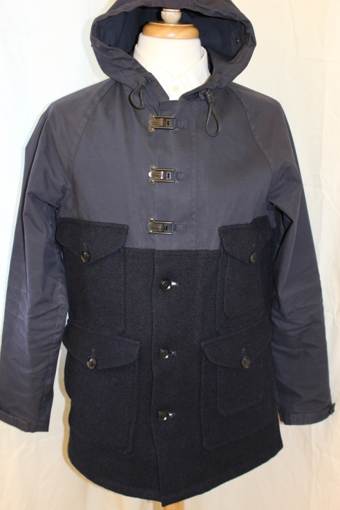 Nigel Cabourn Cameraman jacket. Classic navy blue Harris Tweed/Mackintosh bonded cotton combination. Size 50, xx inches P2P. Probably used no more than a dozen or so times since I got it. One button on cuff needs replacing (not needed, as it's hidden). This jacket cost around 800 pounds new. Asking 350 pounds.