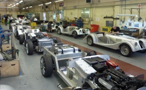A row of +8 roadsters under work.