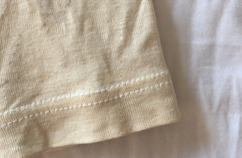 Tea coloured tee compared to a new white tee.